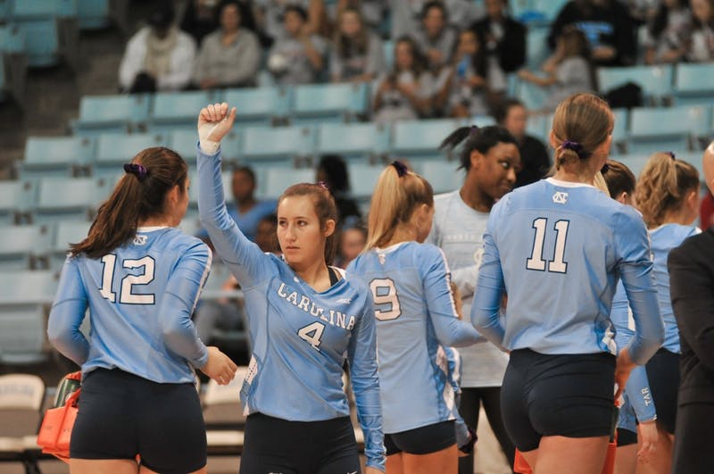 UNC player Olivia Diaz (4) raises a supportive fist at the game against Georgia Tech on Friday, Nov. 1, 2019 in the Carmichael Arena. UNC lost 2-3.
