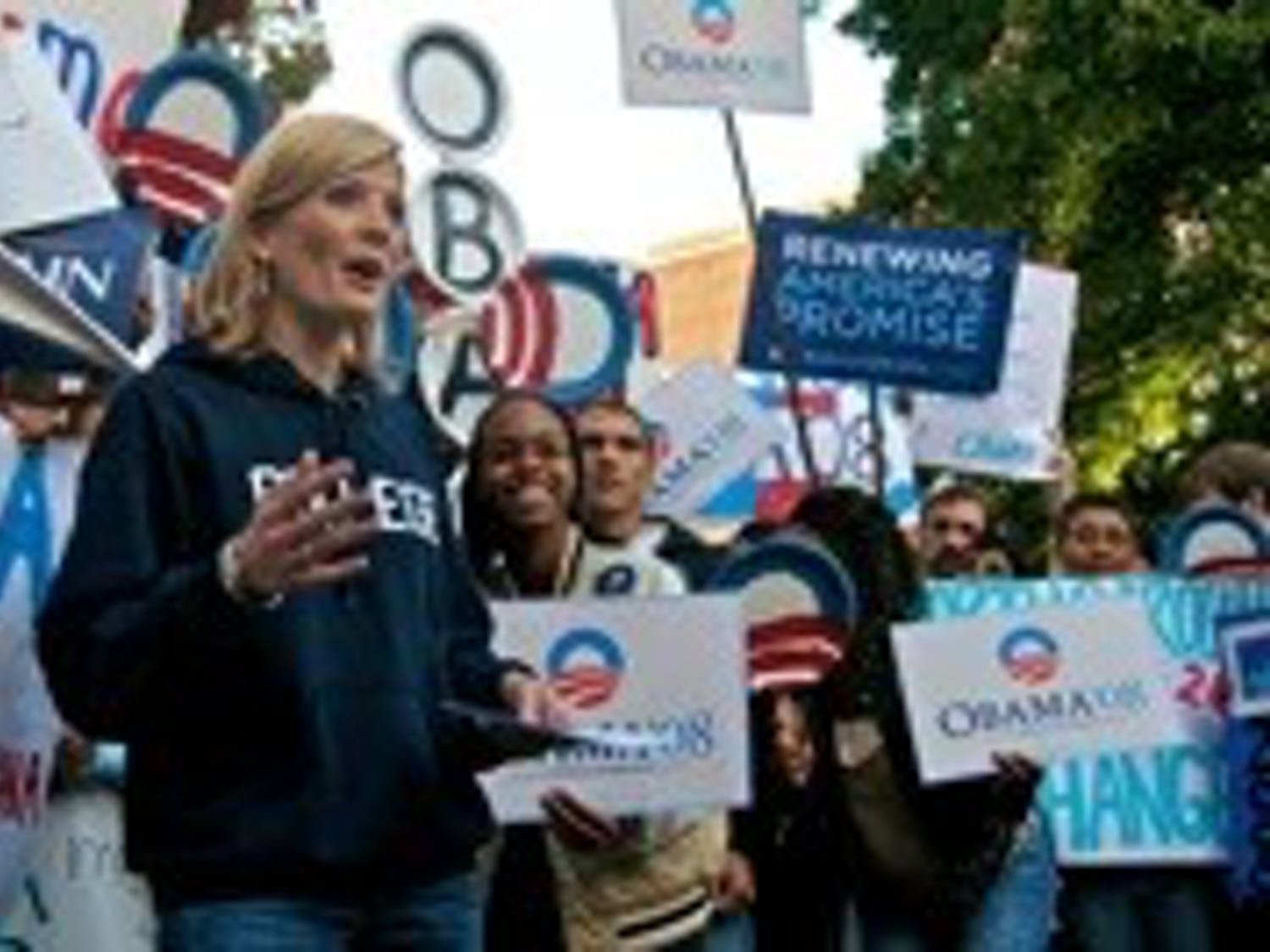 Good Morning America Weekend Edition co-anchor Kate Snow films against a backdrop of avid Obama supporters during a broadcast from Carroll quad early Saturday morning. As a part of an effort to gauge the political climate on college campuses in all 50 states, the morning news show filmed from different UNC campus locations throughout the week. Although filming began at 7 o'clock, students and other members of the surrounding community began organizing and lining up at 5:30 am. Both Obama and McCain supporters lined the walkways and steps of surrounding buildings for a chance to appear on national television.