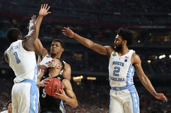 North Carolina wing Theo Pinson (1), forward Kennedy Meeks (3) and guard Joel Berry II (2) defend Gonzaga guard Nigel Williams-Goss (5) in the 2017 championship game.