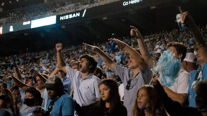 Fans cheer for Tar Heel football in Kenan Stadium at Saturday's home game against the University of Virginia on Saturday. UNC defeated the Cavaliers 59-39, making for their second win of the season.