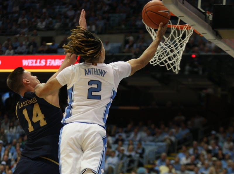 UNC guard Cole Anthony (2) drives by Notre Dame defender Nate Laszewski (14) for the layup on Wednesday, Nov. 6, 2019 in the Dean E. Smith Center. Anthony finished the game with 34 points and 11 rebounds. The Tar Heels beat the Fighting Irish 76-65.