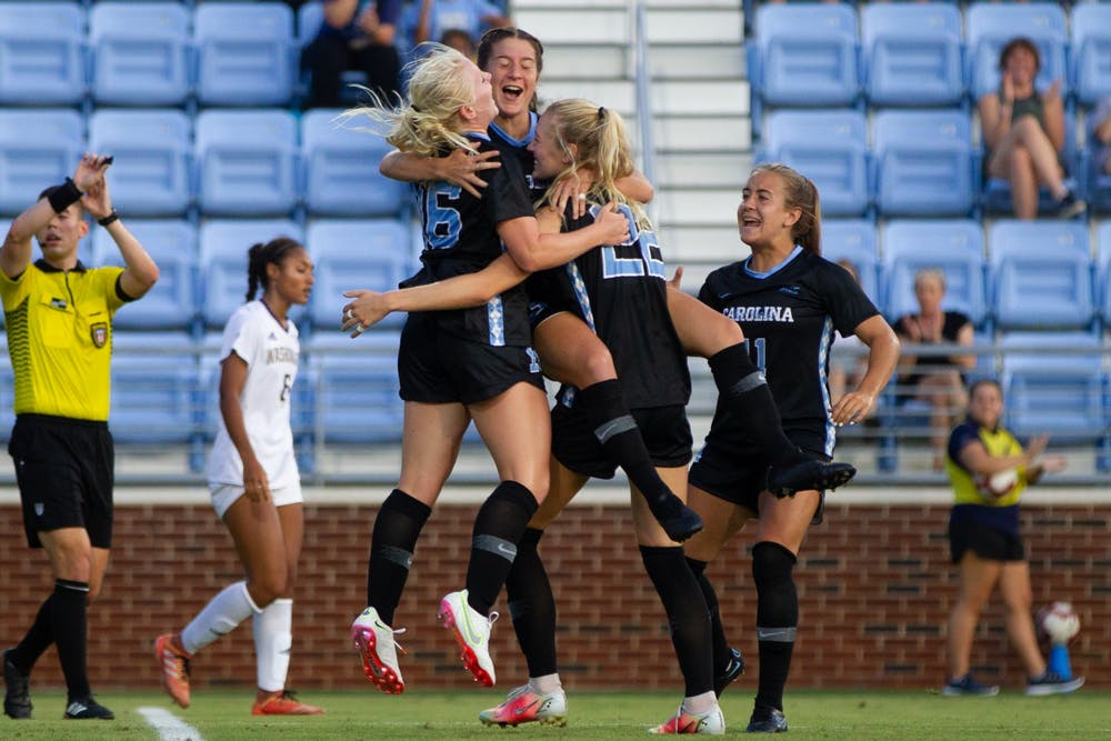 UNC players celebrate after scoring a goal at the soccer game against Washington on Thursday August 19, 2021 at the Dorrance Field.