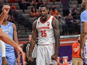 Clemson senior forward Aamir Simms(25) reacts after scoring against North Carolina during the second half of a game at Littlejohn Coliseum on Feb 2, 2021; Clemson, South Carolina, USA. Photo courtesy of Ken Ruinard.