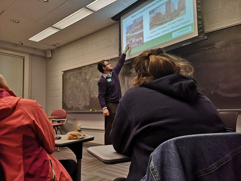 Jay Heikes, Transit-Oriented Development planner at GoTriangle, explains the concept of TOD during a meeting held on Wednesday by Carolina Urbanists, a student organization that aims to help students learn about city and regional planning and to raise awareness of urban issues.