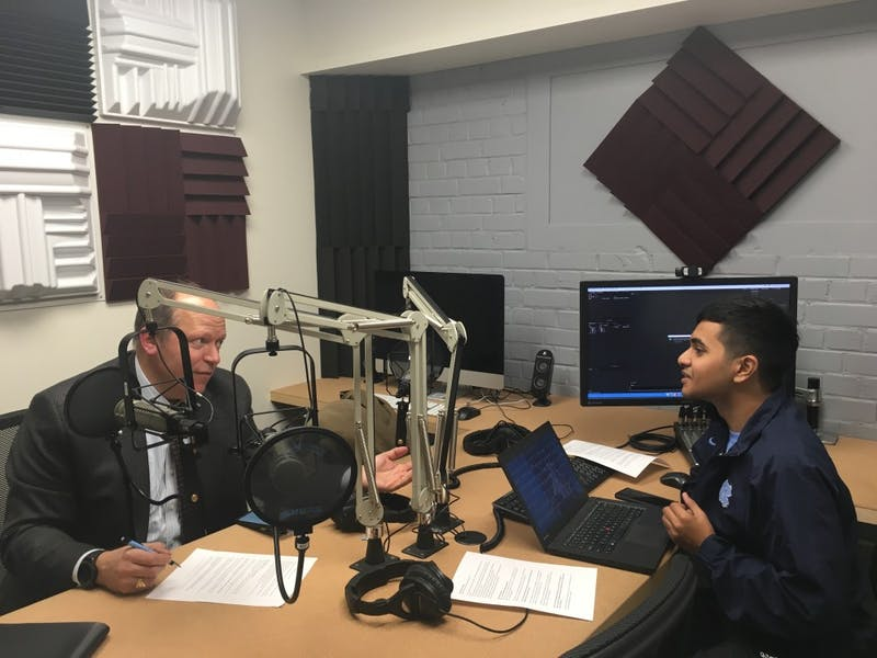UNC alumni Akib Khan, and Ted Zoller, PhD, Director of the Entrepreneurship Center and T.W. Lewis Distinguished Clinical Professor of Strategy and Entrepreneurship, creating the On the Heels of Innovation podcast. Photo courtesy of Aspyn Fulcher.