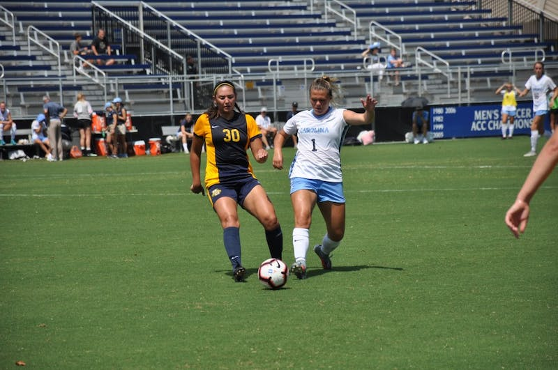 Forward (1) Madison Schultz dribbles past midfielder (30) Ryley Bugay during Sunday's game against Marquette.