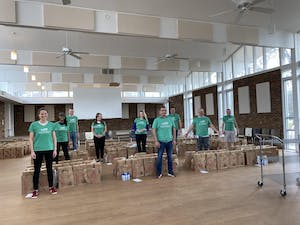 Dova Pharmaceuticals employees sorted and packed shelf-stable meal boxes for Chapel Hill-Carrboro Meals on Wheels on Thursday, March 19, 2020. They packed 1,350 boxes into sets of 5. Photo courtesy of Rachel Bearman.