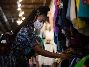 Maxine Eloi, a Durham resident, shops at Rumors, a thrift boutique in Chapel Hill, on Tuesday, Sept. 22, 2020.