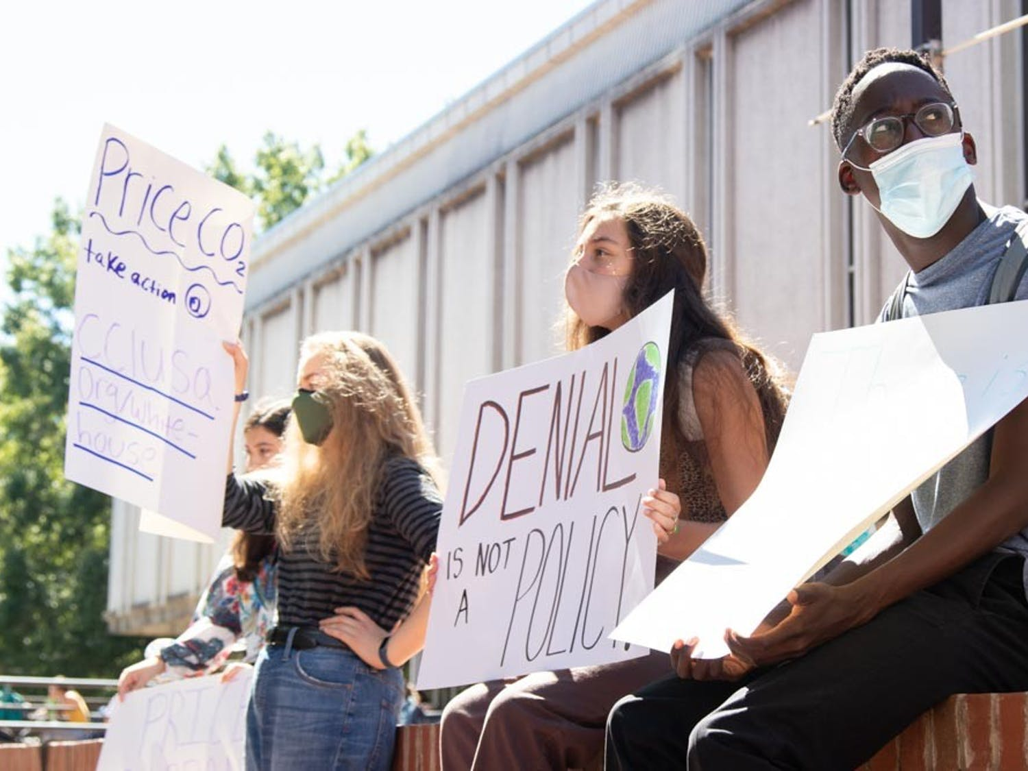 UNC students (from left to right) Jordan Brown, Caitlyn Flanagan, Marisa Romanat, and Tariro Magrira particpate in protest of UNC's coal plant in The Pit on Sep. 24, 2021.