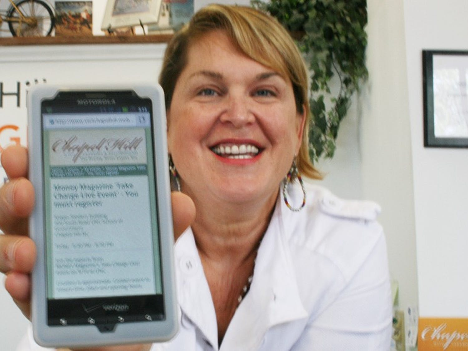 Chapel Hill is moving towards high-tech services; Laurie Pallcioli and Dewey Mooring are launching a new application for tourists and have been working hard at the Chapel Hill tourism office on West Franklin Street.