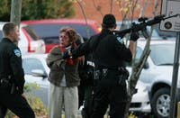A woman was arrested by Chapel Hill police on November 13, 2011 in front of the old Chrysler Building on West Franklin Street.
