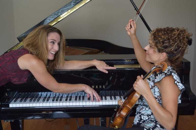 Violinist Jacqueline Saed Wolborsky and pianist Danielle DeSwert Hahn rehearsing for their performance Corsets unLACEd, on Oct. 27. Photo courtesy of Steve Hahn.