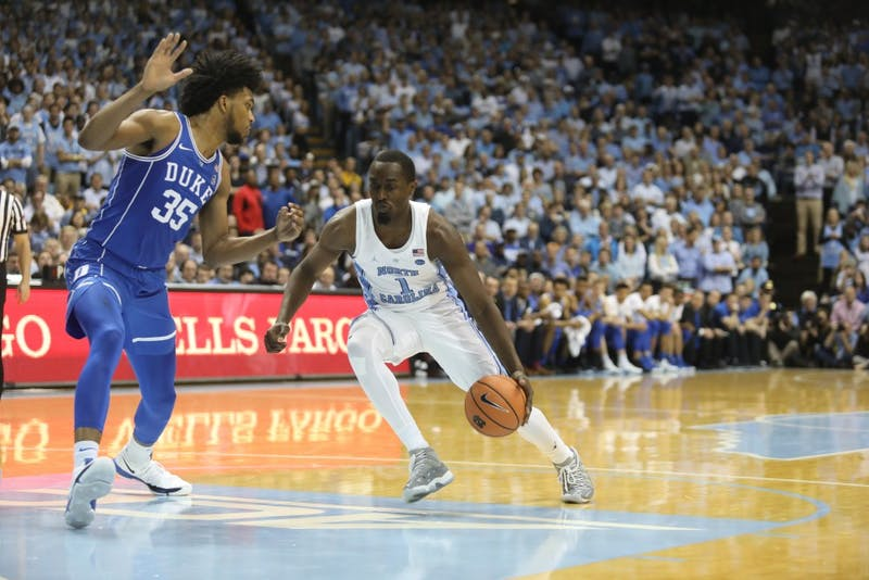North Carolina forward Theo Pinson (1) drives the ball during Thursday night's home game against Duke.