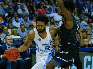 North Carolina guard Joel Berry (2) drives in on a Butler defender during their Sweet 16 matchup on Friday.