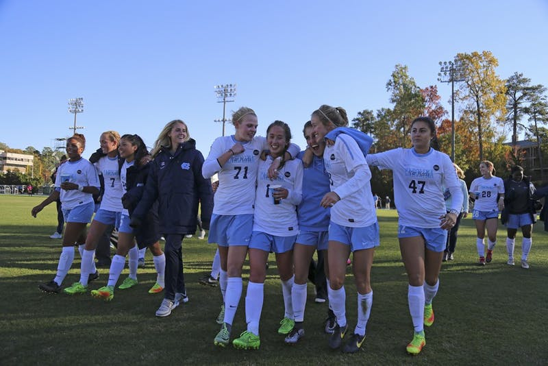The UNC women's soccer team walks off the field in joy after defeating Clemson 1-0 in the third round of the NCAA tournament on Sunday.