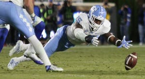 Safety Donnie Miles (15) dives for an interception against Duke in 2016.