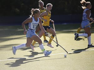 Senior midfielder Ashley Hoffman (13) dribbles the ball past Michigan players during the second round of the NCAA Tournament at Karen Shelton Stadium on Monday. Hoffman is a member of the U.S. National Team and was named to the 2018 Preseason All-ACC Team.