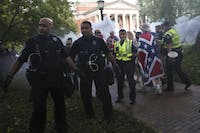Police from across North Carolina quickly escort demonstrators from McCorkle Place after their scheduled demonstration on Saturday, Sept. 8, 2019. Among them is Sergeant Svetlana Bostelman. Silent Sam activist Julia Pulawksi filed a motion that Bostelman gave false testimony that led to Pulawksi's conviction.