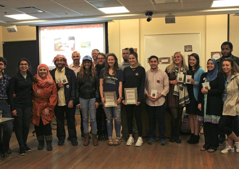 Participants in the first ever calligraphy contest at UNC line up after receiving their prizes for creating their works of calligraphy.