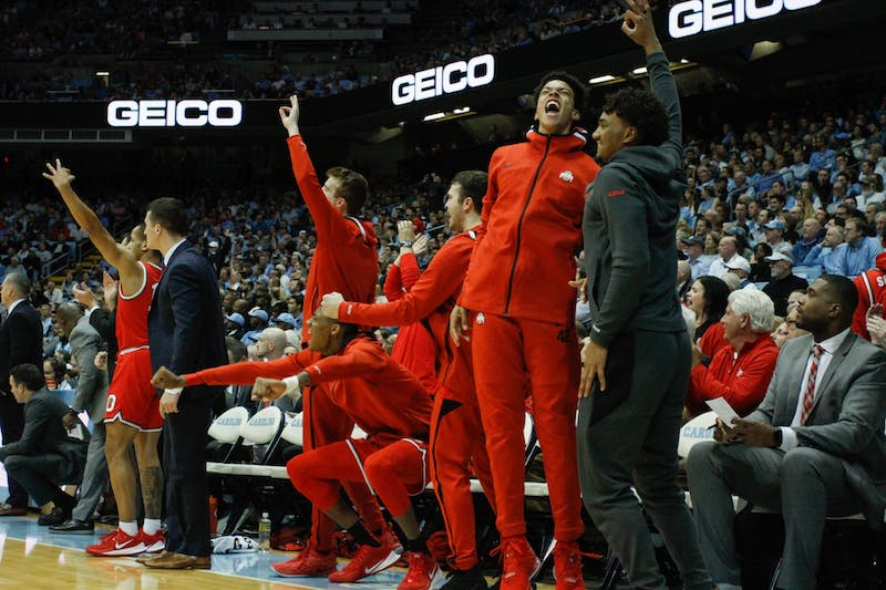 The Ohio State bench celebrates after scoring a three-pointer in the game against UNC in the Smith Center on Wednesday, Dec. 4, 2019. UNC lost to Ohio State 74-49.