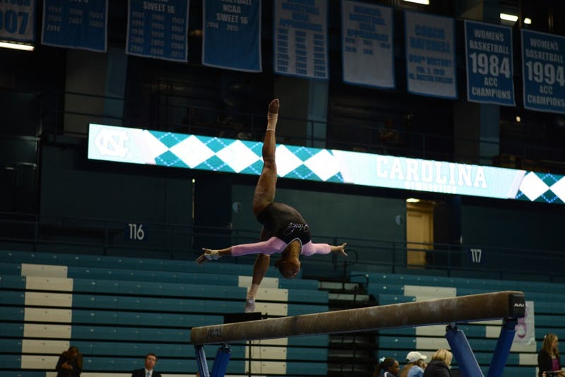 Khazia Hislop performs her beam routine at the annual Pink Meet in February 2017.