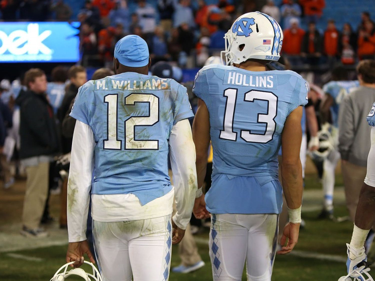 Marquise Williams (12) and Mack Hollins (13) walk back to the Carolina locker room at the conclusion of the game.
