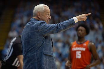 Head Coach Roy Williams talks to the players during the game against Clemson. UNC lost to Clemson 79-76, ending the Tigers 0-59 losing streak in Chapel Hill.