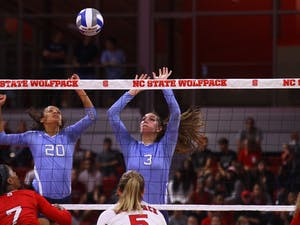 Taylor Treacy (20) and Beth Nordhorn (3) go up for the block against N.C. State.
