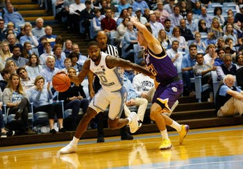 Junior guard Seventh Woods (0) dribbles the ball past redshirt freshman Hunter Vick (20) in the Dean Smith Center on Friday, Nov. 16, 2018. UNC beat Tennessee Tech 108-58.