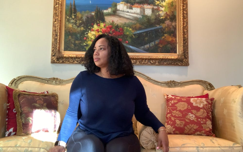 <p>Jackie Carr-Martinez poses for a virtual portrait in her home in Greensboro on Feb. 23, 2021. Carr-Martinez, who identifies as African-American, Indian and Guyanese, was afraid to return to the hospital after a painful experience with a white doctor the night before her first child's birth.</p>