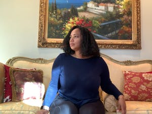 Jackie Carr-Martinez poses for a virtual portrait in her home in Greensboro on Feb. 23, 2021. Carr-Martinez, who identifies as African-American, Indian and Guyanese, was afraid to return to the hospital after a painful experience with a white doctor the night before her first child's birth.