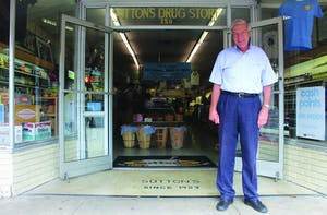 Owner John Woodard stands outside Sutton's Drug Store. He will be inducted into the Chapel Hill-Carrboro Chamber of Commerce Business Hall of Fame.