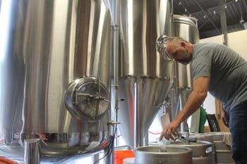 David Larsen. the owner of YesterYears Brewery, from Pensacola prepares kegs with freshly brewed beer.