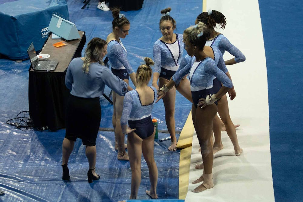 UNC gymnastics prepare for their floor routine during a meet against George Washington in Carmichael Arena on Friday, Feb. 28, 2020. The Tar Heels placed first against the Colonials.