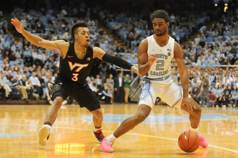 UNC first-year guard Coby White (2) dribbles past Virginia Tech sophomore guard Wabissa Bede (3) in the Smith Center on Monday, Jan. 21, 2019. The Tar Heels won 103-82.