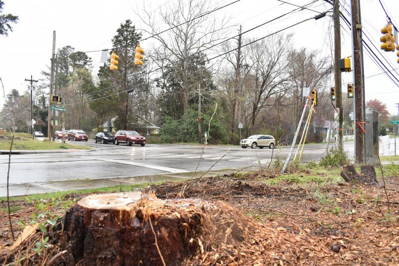 At the intersection of Estes Dr. and North Greensboro St. trees have been cut down and power lines are being relocated as the city of Carrboro is starting to prepare for construction on a roundabout on that intersection. Photographed on April 2, 2019.