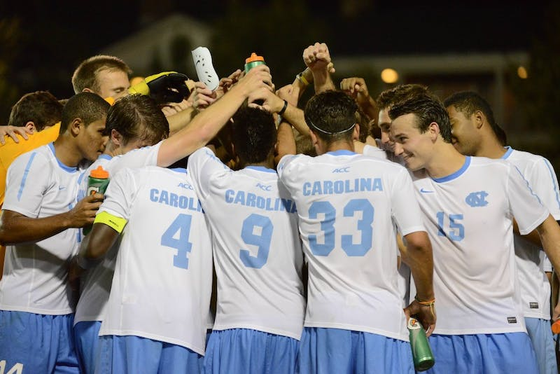 UNC huddles after defeating Monmouth 1-0 in the second overtime period.