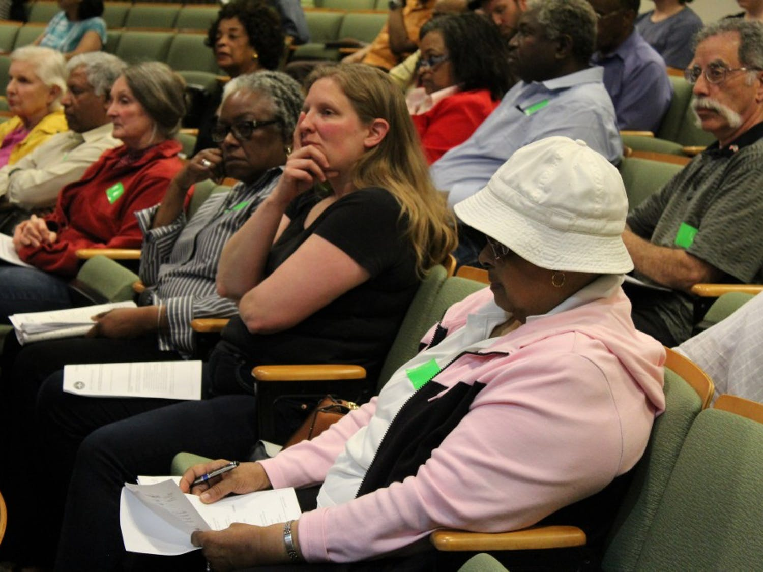 On Wednesday, April 17, 2019 the Chapel Hill Town Council holds a public hearing at Chapel Hill Town Hall for the historic Rodgers Road rezoning initiative. Residents and other supporters wore green tape to show their support for the rezoning movement.