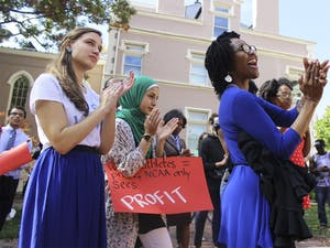 """With the Campus Y and South Building as backdrops, sign-holding supporters turned out to applaud the speakers at Wednesday's rally, """"Speaking Back to the Wainstein Report."""""""