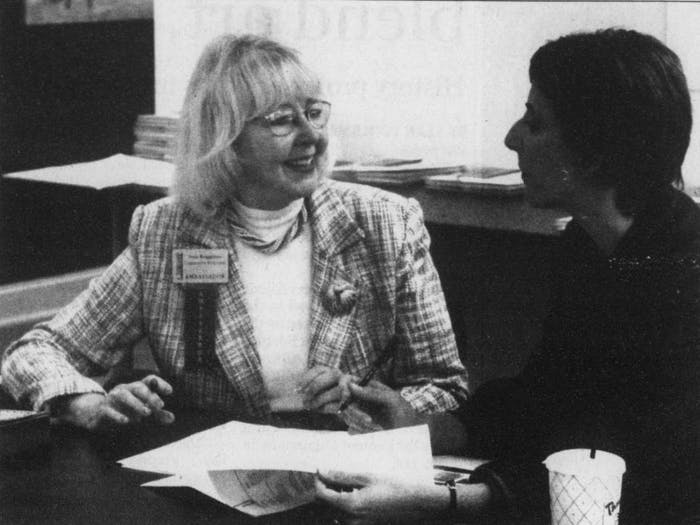 DTH Archive. Irene Briggaman (left) laughs with Chrissy Beck at the Chapel Hill Chamber of Commerce while discussing the 2005 membership drive. Photo by Chris Fields.