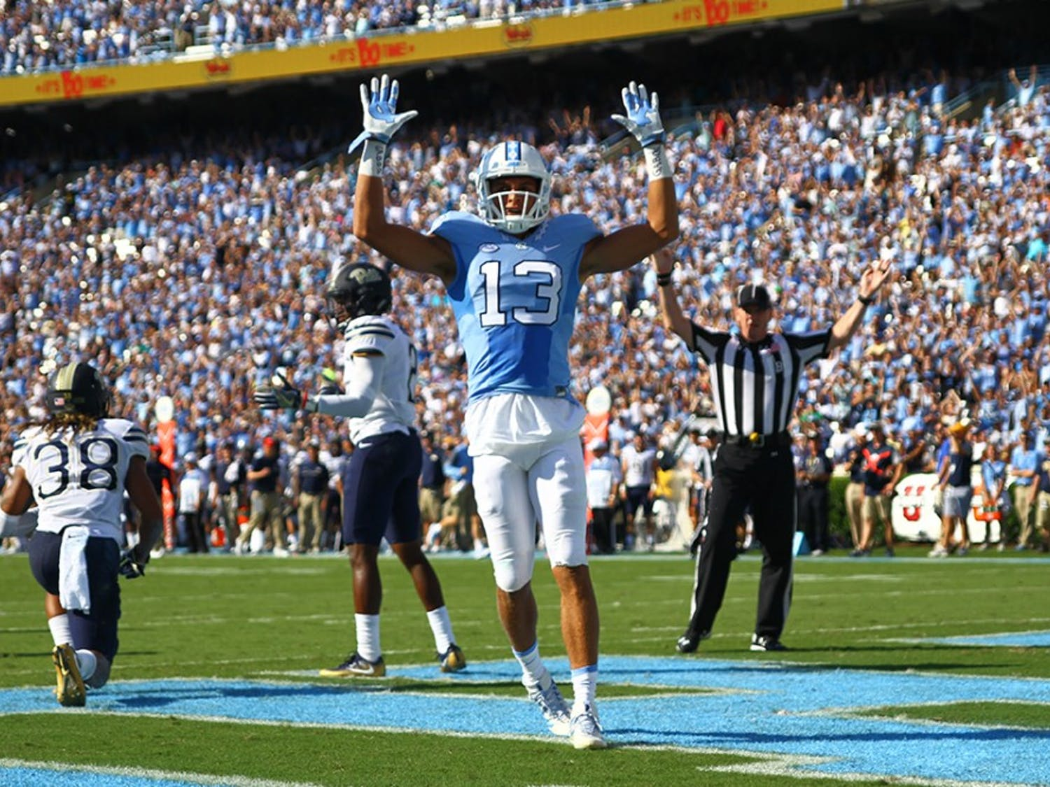 UNC wide receiver Mack Hollins (13) celebrates after scoring a touchdown against Pitt. The Tar Heels defeated the Panthers 37-36 on Saturday.