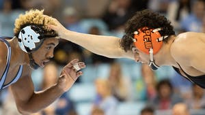 UNC redshirt junior Kennedy Monday and Princeton sophomore Grant Cuomo wrestle in weight class 165 on Friday, Jan. 11, 2020 in Carmichael Arena. No. 17 UNC defeated No. 12 Princeton 25-11.