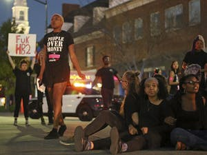 On-campus activist groups centered around people of color and queer/transgender advocacy shut down the intersection of Franklin St. and Columbia St. on Mar 29 in protest of newly passed House Bill 2.