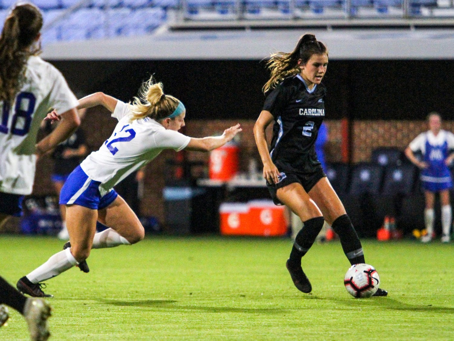 UNC freshman defender Abby Allen (2) dribbles downfield on Dorrance Field Oct. 23, 2020. The Tar Heels beat the Blue Devils 1-0.