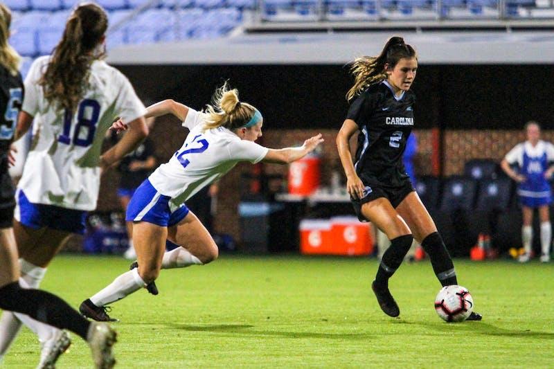 UNC freshman defender Abby Allen (2) dribbles downfield on Dorrance Field Oct. 23, 2020. The Tar Heels beat the Blue Devils 1-0.