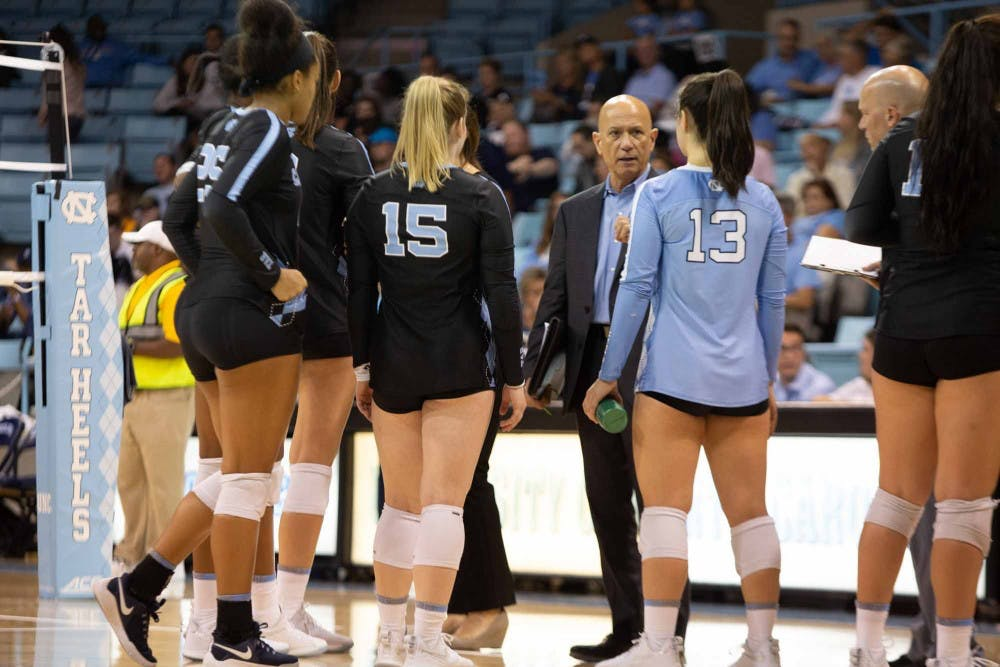 Head coach, Joe Sagula, talks to the players during a time out. UNC won agaisnt  FSU 3-2 at Carmichael Arena on Sunday Oct. 13, 2019.