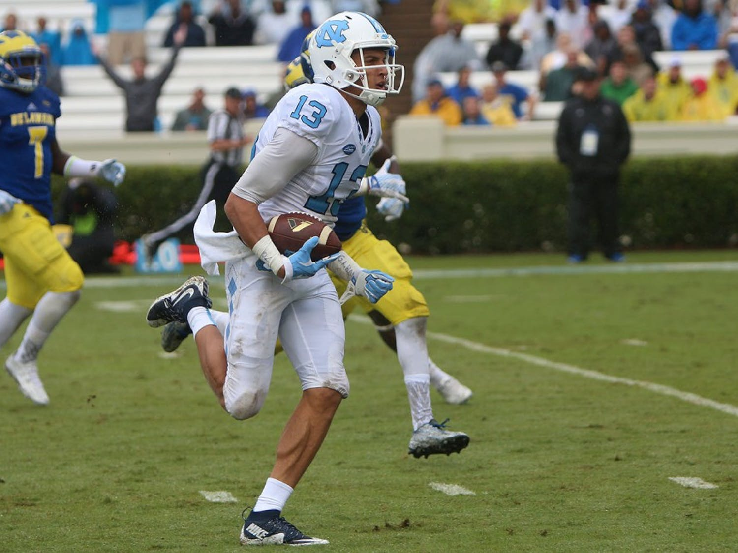 Wide receiver Mack Hollins (13) runs toward the end zone for a touchdown off of a 64yard pass from Mitch Trubisky.