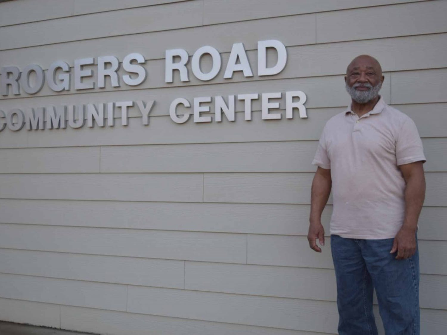 Robert Campbell, the head of the Rogers-Eubanks Neighborhood Association, poses in front of the Rogers Road Community Center, on Thursday, Feb. 21, 2019. Campbell has been part of the Rogers Road Neighborhood Zoning Initiative since the beginning and wants to make sure that the diversity of the community is accounted for during the process. He also says that everyone in the community should be part of the conversation, regardless of what language they speak.