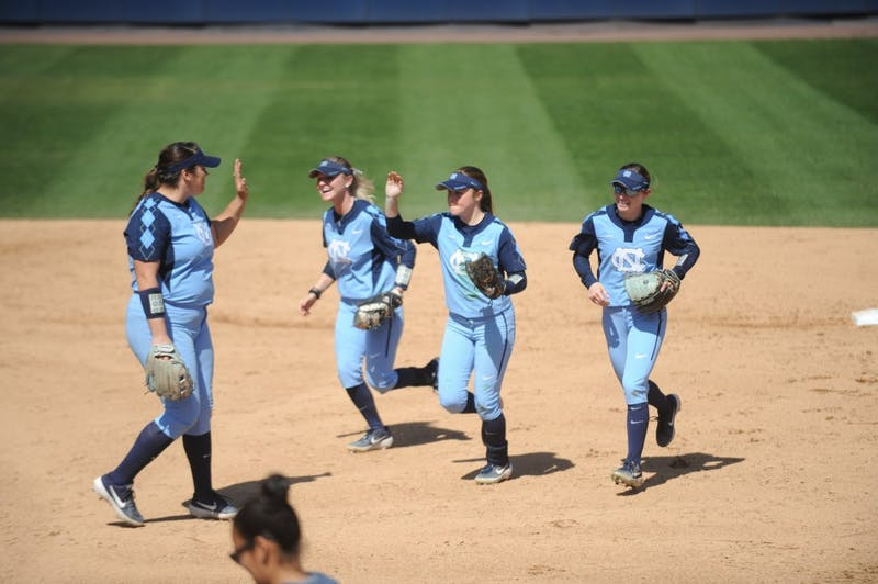 Players celebrate during UNC's Softball game vs. Georgia Tech on Sunday, Mar. 24. UNC lost the game 3-2.