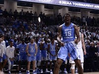 UNC power forward Garrison Brooks (15) screams in the excitement following his slam dunk against Wofford in their first game of the season. UNC won 78-67 in the Richardson Indoor Stadium, Spartanburg, SC on Nov. 6, 2018.